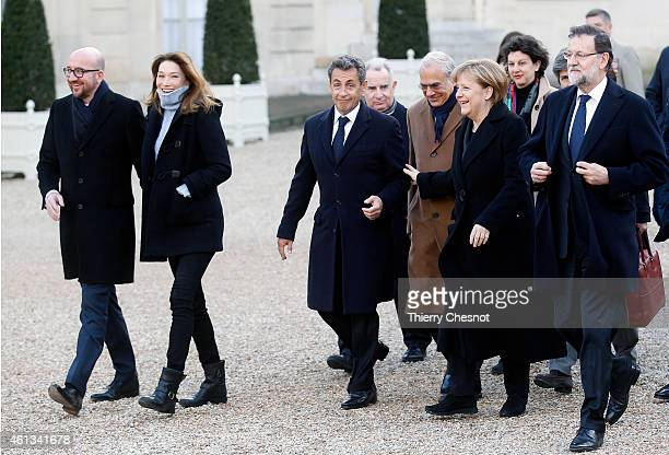 France's former President and leader of the rightwing UMP party Nicolas Sarkozy and his wife Carla BruniSarkozy German Chancellor Angela Merkel and...