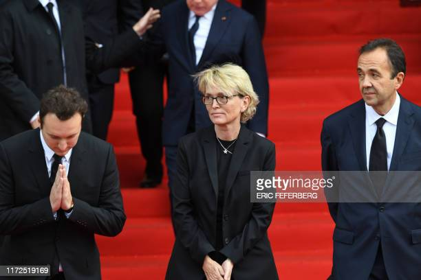 TOPSHOT France's former President Jacques Chirac's daughter Claude Chirac her son Martin ReyChirac and husband Frederic SalatBaroux thank members of...