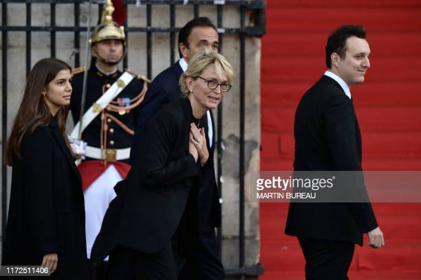TOPSHOT France's former President Jacques Chirac's daughter Claude Chirac waves as she arrives with her son Martin ReyChirac and her husband Frederic...