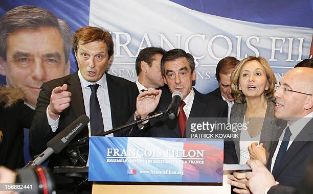 France's former Prime Minister Francois Fillon flanked by his team Jerome Chartier , Christian Estrosi, Valerie Pecresse and Eric Ciotti speaks and...