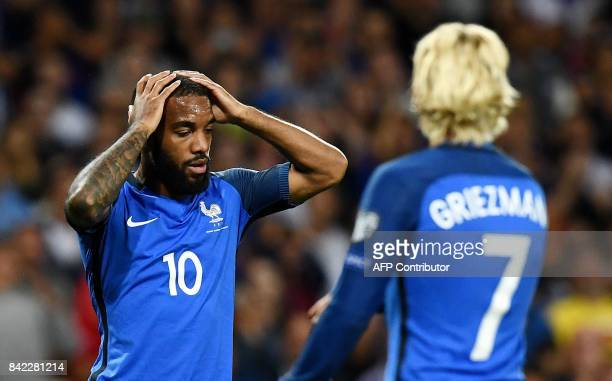 France's forward Alexandre Lacazette reacts after missing a shot on the goal during the FIFA World Cup 2018 qualifying football match France vs...