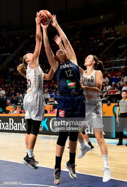 France's forward Alexia Chartereau vies with Belgium's guard Julie Allemand and Belgium's forward Antonia Delaere during the FIBA 2018 Women's...