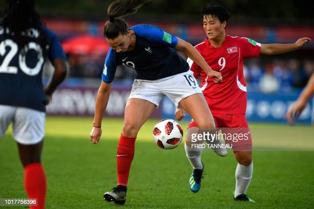 France's forward Amelie Delabre vies for the ball with Korea DPR's midfielder Pom Ui Kim during the women World Cup 2018 U20 football match between...