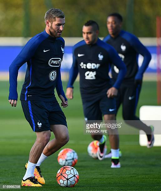 France's forward Andre Pierre Gignac controls the ball in fornt forward Dimitri Payet during a training session in Clairefontaine en Yvelines on...