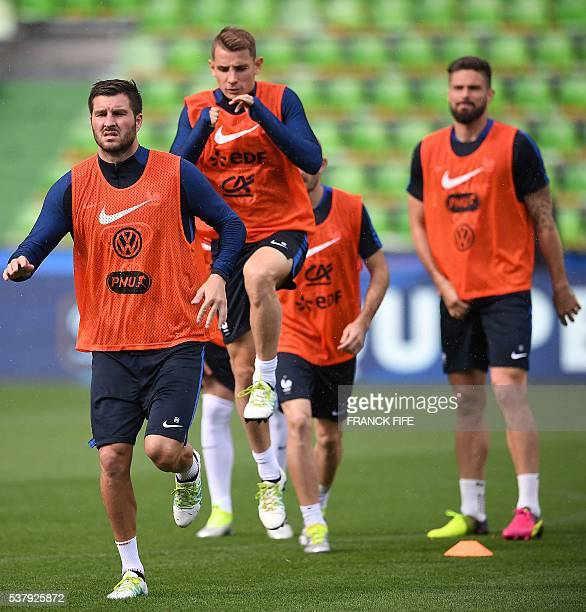 France's forward Andre Pierre Gignac France's defender Christophe Jallet and France's forward Olivier Giroud attend in a training session at the St...