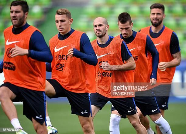 France's forward Andre Pierre Gignac France's defender Lucas Digne France's defender Christophe Jallet France's midfielder Morgan Schneiderlin and...