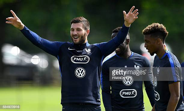 France's forward Andre Pierre Gignac gestures before a training session in ClairefontaineenYvelines on May 28 as part of the team's preparation for...