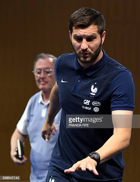 France's forward Andre Pierre Gignac leaves a press conference in ClairefontaineenYvelines on June 7 three days ahead of the beginning of the Euro...
