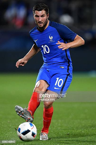 France's forward Andre Pierre Gignac passes the ball during the friendly football match between France and Scotland at the St Symphorien Stadium in...