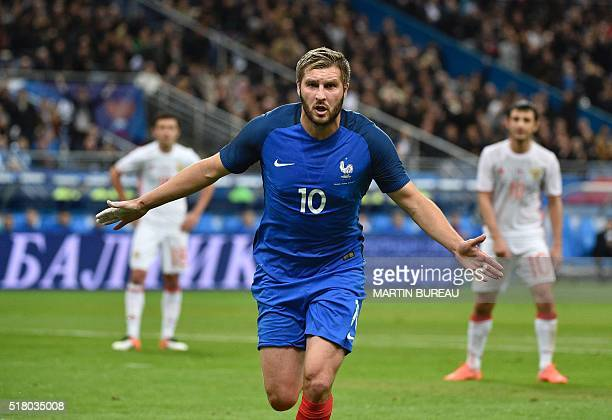 France's forward AndrePierre Gignac celebrates scoring the 20 during the international friendly football match between France and Russia at the Stade...