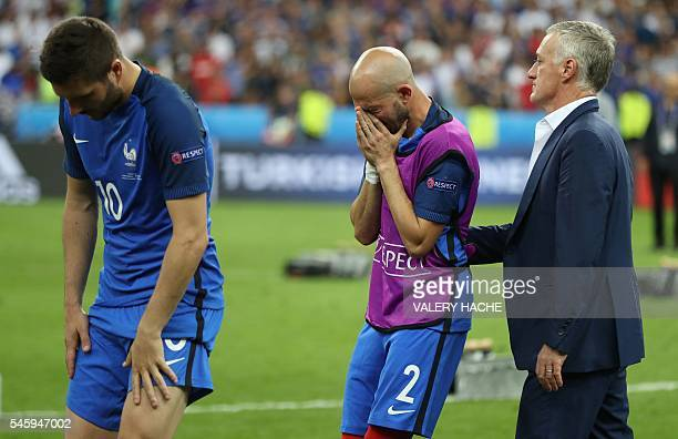 France's forward AndrePierre Gignac France's defender Christophe Jallet and France's coach Didier Deschamps react after France lost the Euro 2016...