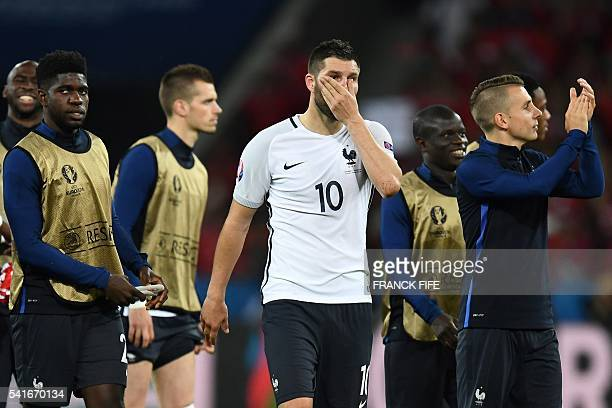 France's forward AndrePierre Gignac reacts following their 00 draw in the Euro 2016 group A football match between Switzerland and France at the...