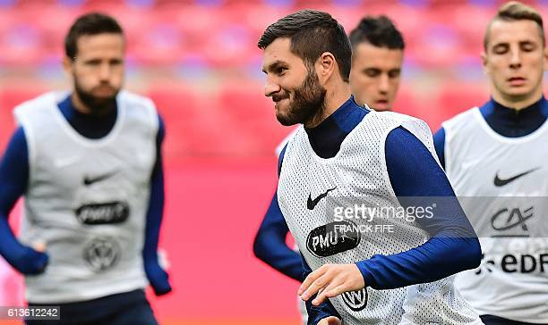 France's forward AndrePierre Gignac runs during a training session at the Amsterdam Arena in Amsterdam on October 9 on the eve of the FIFA World Cup...