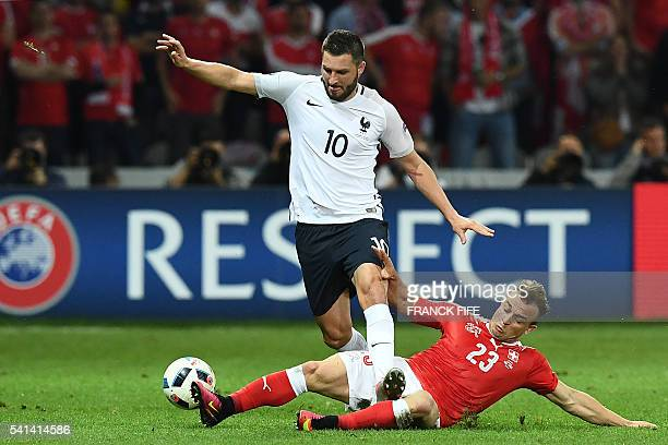 TOPSHOT France's forward AndrePierre Gignac vies for the ball agansit Switzerland's midfielder Xherdan Shaqiri during the Euro 2016 group A football...
