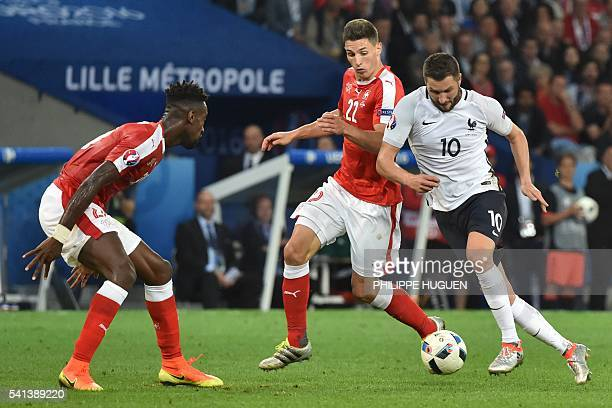 France's forward AndrePierre Gignac vies for the ball with Switzerland's defender Fabian Schaer during the Euro 2016 group A football match between...