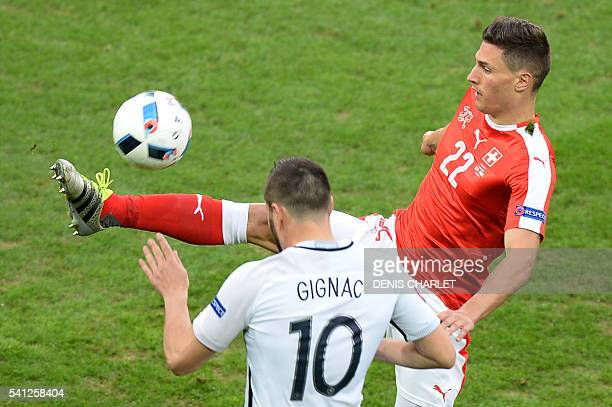 France's forward AndrePierre Gignac vies with Switzerland's defender Fabian Schaer during the Euro 2016 group A football match between Switzerland...