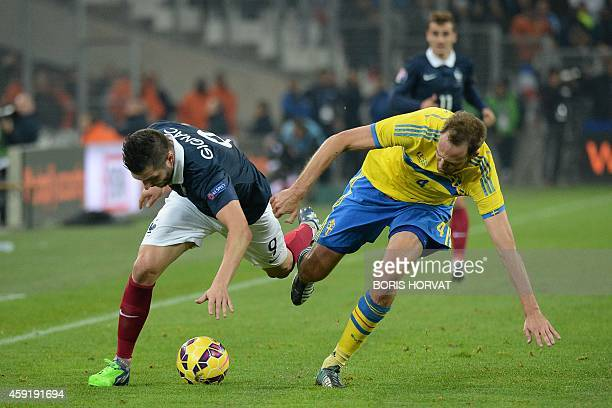 France's forward AndréPierre Gignac vies with Swedish's defender Andreas Granqvist during the friendly football match France vs Sweden on November 18...