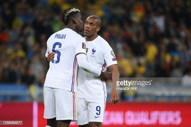 France's forward Anthony Martial celebrates with France's midfielder Paul Pogba after scoring his team's first goal during the FIFA World Cup Qatar...