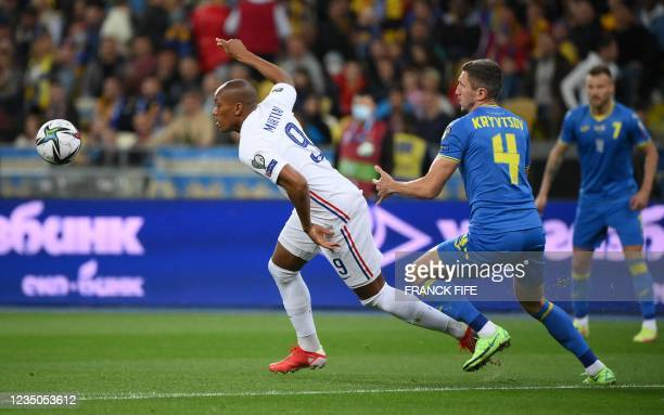 France's forward Anthony Martial fights for the ball with Ukraine's defender Serhiy Kryvtsov during the FIFA World Cup Qatar 2022 Group D...