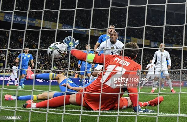 France's forward Anthony Martial scores his team's first goal past Ukraine's goalkeeper Andrey Pyatov during the FIFA World Cup Qatar 2022 Group D...