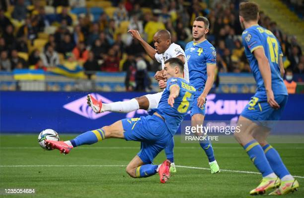 France's forward Anthony Martial shoots and scores his team's first goal during the FIFA World Cup Qatar 2022 Group D qualification football match...