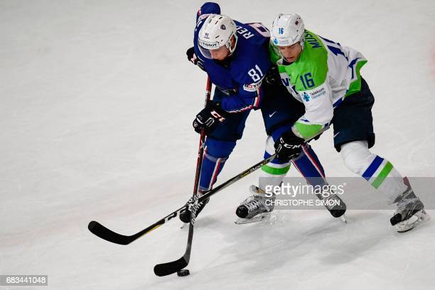 France's forward Anthony Rech vies with Slovenia's forward Ales Music during the IIHF Men's World Championship group B ice hockey match between...