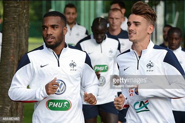 France's forward Antoine Griezmann and Alexandre Lacazette during a training session at the French national football team centre in...