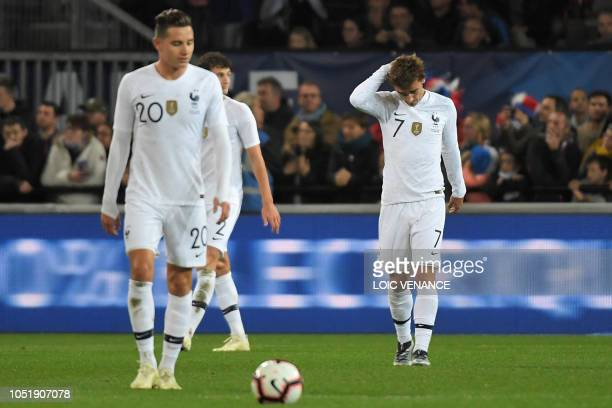 France's forward Antoine Griezmann and France's forward Florian Thauvin react after a goal of Iceland during the friendly football match between...