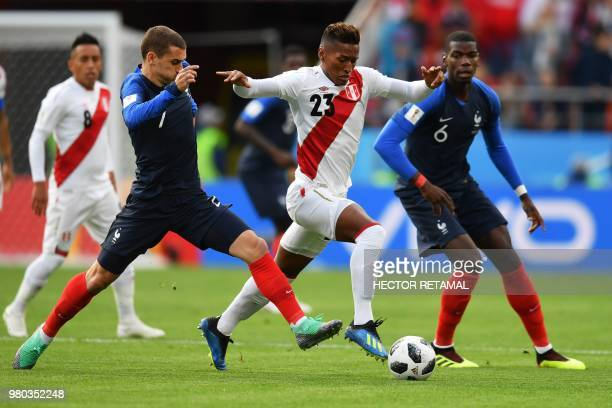 TOPSHOT France's forward Antoine Griezmann and Peru's midfielder Pedro Aquino compete for the ball during the Russia 2018 World Cup Group C football...
