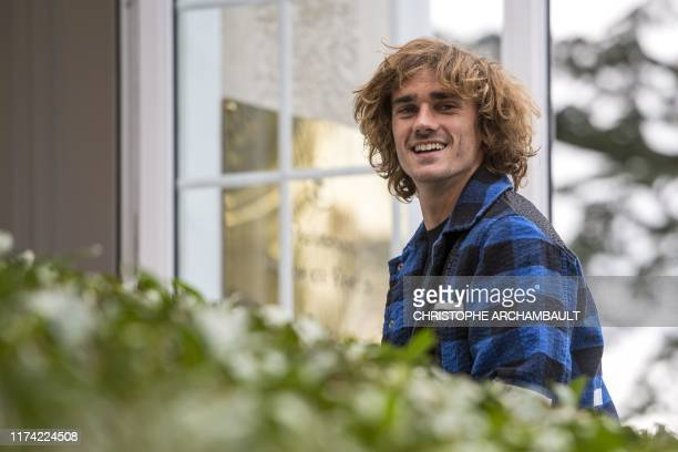France's forward Antoine Griezmann arrives for a training session in Clairefontaine-en-Yvelines, southwest of Paris on October 7, 2019 ahead of the...