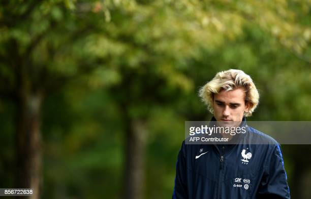France's forward Antoine Griezmann arrives for a training session in Clairefontaine-en-Yvelines on October 2, 2017 as part of the team's preparation...