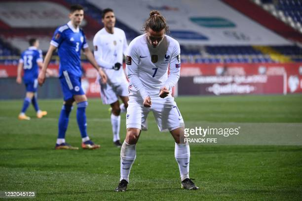 France's forward Antoine Griezmann celebrates after scoring a goal during the FIFA World Cup Qatar 2022 qualification Group D football match between...