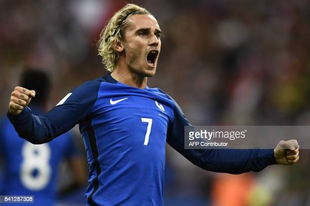 TOPSHOT France's forward Antoine Griezmann celebrates after scoring a goal during the 2018 FIFA World Cup qualifying football match France vs...