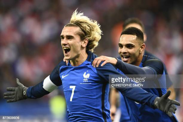 TOPSHOT France's forward Antoine Griezmann celebrates after scoring a goal during the friendly football match between France and Wales at the Stade...