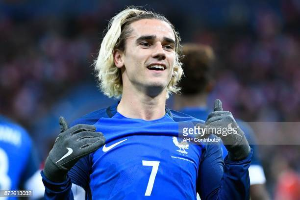France's forward Antoine Griezmann celebrates after scoring a goal during the friendly football match between France and Wales at the Stade de France...