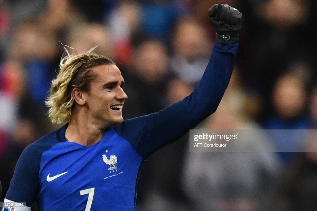 France's forward Antoine Griezmann celebrates after scoring a goal during the friendly football match between France and Wales at the Stade de France stadium, in Saint-Denis, on the outskirts of Paris, on November 10, 2017. /