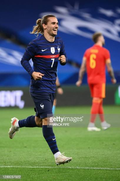 France's forward Antoine Griezmann celebrates after scoring his team's second goal during the friendly football match between France and Wales at the...