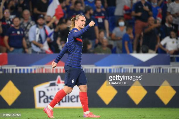 France's forward Antoine Griezmann celebrates after scoring his team's second goal during the FIFA World Cup Qatar 2022 Group D qualification...