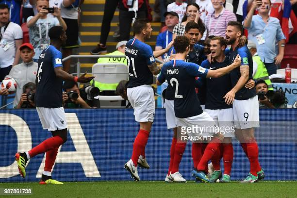France's forward Antoine Griezmann celebrates after scoring the opener during the Russia 2018 World Cup round of 16 football match between France and...