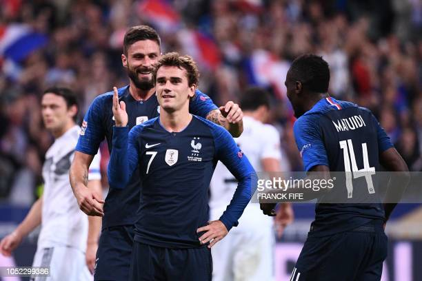 TOPSHOT France's forward Antoine Griezmann celebrates after scoring their second goal on a penalty kick during the UEFA Nations League football match...