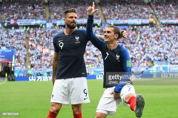France's forward Antoine Griezmann celebrates after scoring with France's forward Olivier Giroud during the Russia 2018 World Cup round of 16...