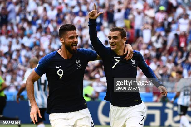 TOPSHOT France's forward Antoine Griezmann celebrates after scoring with France's forward Olivier Giroud during the Russia 2018 World Cup round of 16...