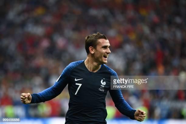 TOPSHOT France's forward Antoine Griezmann celebrates Croatia's forward Mario Mandzukic's own goal during their Russia 2018 World Cup final football...