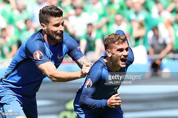 France's forward Antoine Griezmann celebrates scoring a goal next to France's forward Olivier Giroud during the Euro 2016 round of 16 football match...