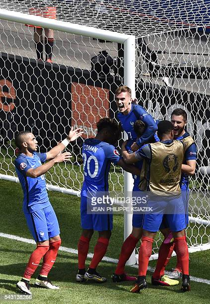 France's forward Antoine Griezmann celebrates scoring a second goal with team mates during the Euro 2016 round of 16 football match between France...