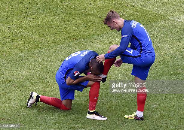 France's forward Antoine Griezmann celebrates scoring a second goal with France's forward Dimitri Payet during the Euro 2016 round of 16 football...