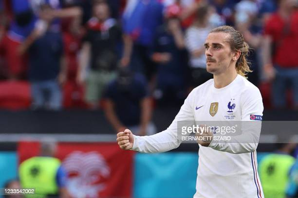 France's forward Antoine Griezmann celebrates scoring his team's first goal during the UEFA EURO 2020 Group F football match between Hungary and...