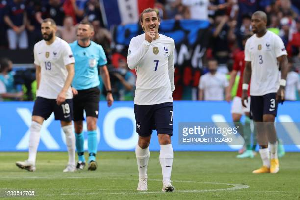 France's forward Antoine Griezmann celebrates scoring his team's first goal with his teammates during the UEFA EURO 2020 Group F football match...