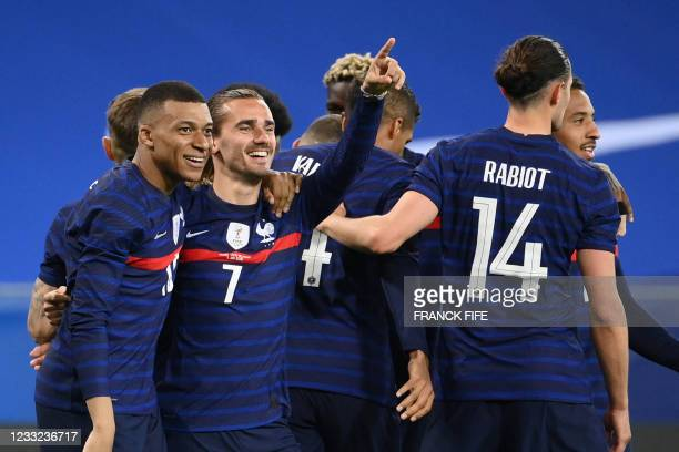 France's forward Antoine Griezmann celebrates with France's forward Kylian Mbappe past teammates after scoring his team's second goal during the...