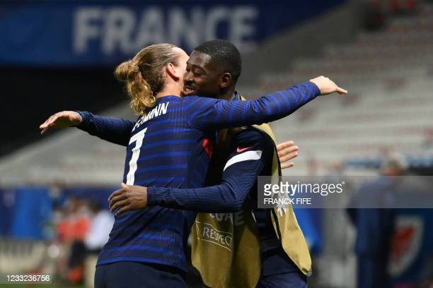 France's forward Antoine Griezmann celebrates with France's forward Ousmane Dembele after scoring his team's second goal during the friendly football...